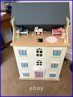 Beautiful Large Wooden Dolls House complete with miniature furniture and people