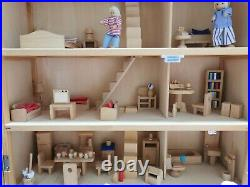 Classic four storey wooden dolls house with all furniture