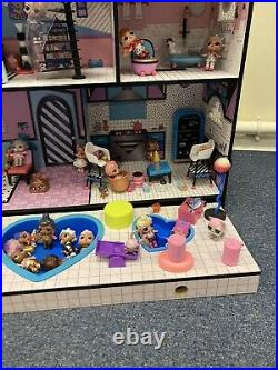 L. O. L. Surprise! O. M. G. House Real Wooden Doll House With 42 Dolls & Accessories