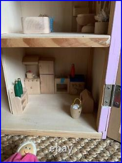 Large Wooden Dolls House With Furniture and Extended Family