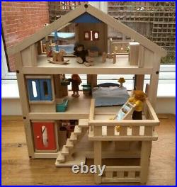 Plan Toys wooden terrace dolls' house with furniture, accessories and family