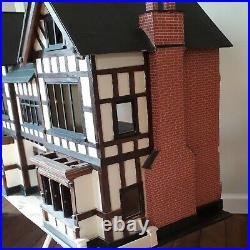 Vintage Large Wooden Dolls House 39-in in length 28-in hi loft find needs finish