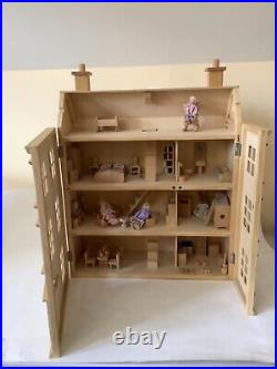 Wooden Dolls house with lots of contents