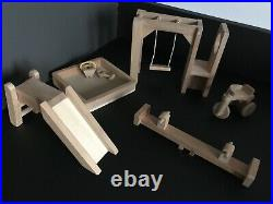Wooden dolls house Plan toys Brand