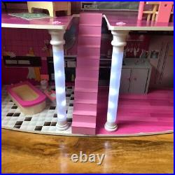 Wooden dolls house and furniture