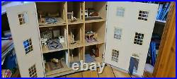 Wooden dolls house and furniture bundle, two working lights