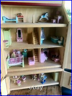 Wooden dolls house and huge amount of furniture. Handmade. Very good condition