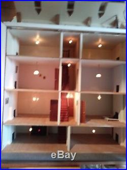 Wooden dolls house with electric lighting