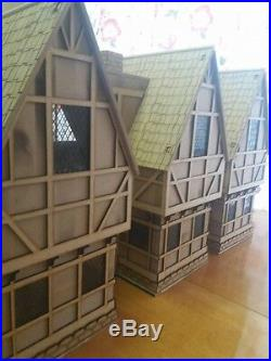 Wooden made-to-order Tudor Dolls House. Set of two